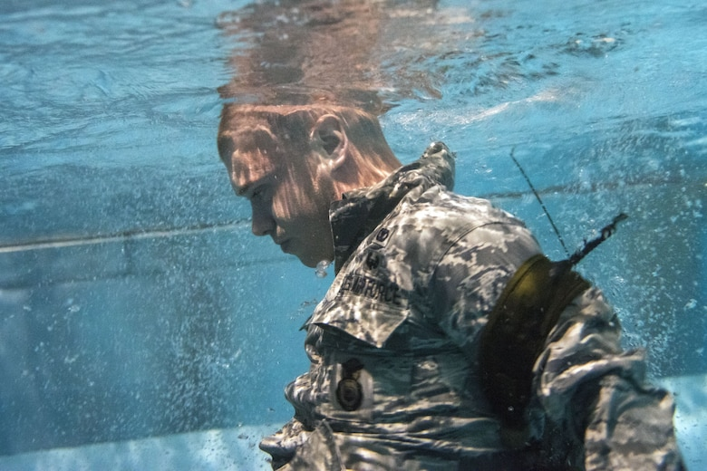 An Airman attempts to ditch his gear while underwater during a water survival assessment, Feb. 9, 2018, at Moody Air Force Base, Ga. The assessment is part of a three-day ranger assessment that's designed to determine whether Airmen are ready to attend the Air Force pre Ranger-Assessment Course held at Fort Bliss Army post, Tx. The Ranger cadre test Airmen's physical fitness, tactical abilities, land navigation skills, leadership qualities, water confidence and academic ability to determine if they have the knowledge and will to become Ranger qualified. (U.S. Air Force photo by Airman Eugene Oliver)