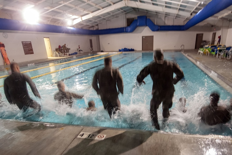 Airmen jump into a pool during a water survival assessment, Feb. 9, 2018, at Moody Air Force Base, Ga. The assessment is part of a three-day ranger assessment that's designed to determine whether Airmen are ready to attend the Air Force pre Ranger-Assessment Course held at Fort Bliss Army post, Texas. The Ranger cadre test Airmen's physical fitness, tactical abilities, land navigation skills, leadership qualities, water confidence and academic ability to determine if they have the knowledge and will to become Ranger qualified. (U.S. Air Force photo by Airman Eugene Oliver)