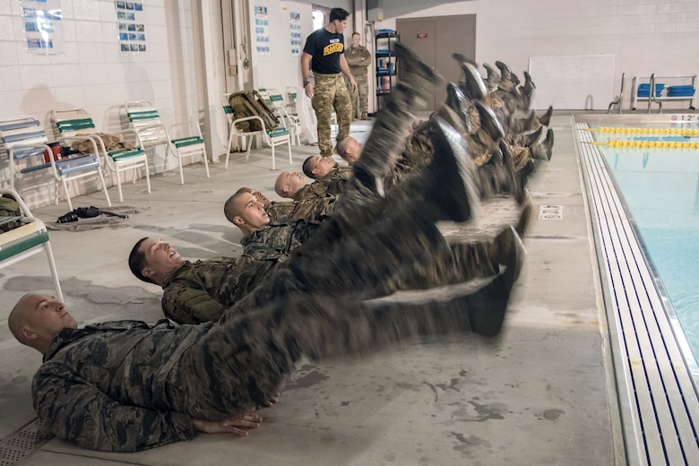 Airmen perform flutter kicks alongside a pool during a water survival assessment, Feb. 9, 2018, at Moody Air Force Base, Ga. The assessment is part of a three-day ranger assessment that's designed to determine whether Airmen are ready to attend the Air Force pre Ranger-Assessment Course held at Fort Bliss Army post, Texas. The Ranger cadre test Airmen's physical fitness, tactical abilities, land navigation skills, leadership qualities, water confidence and academic ability to determine if they have the knowledge and will to become Ranger qualified. (U.S. Air Force photo by Airman Eugene Oliver)