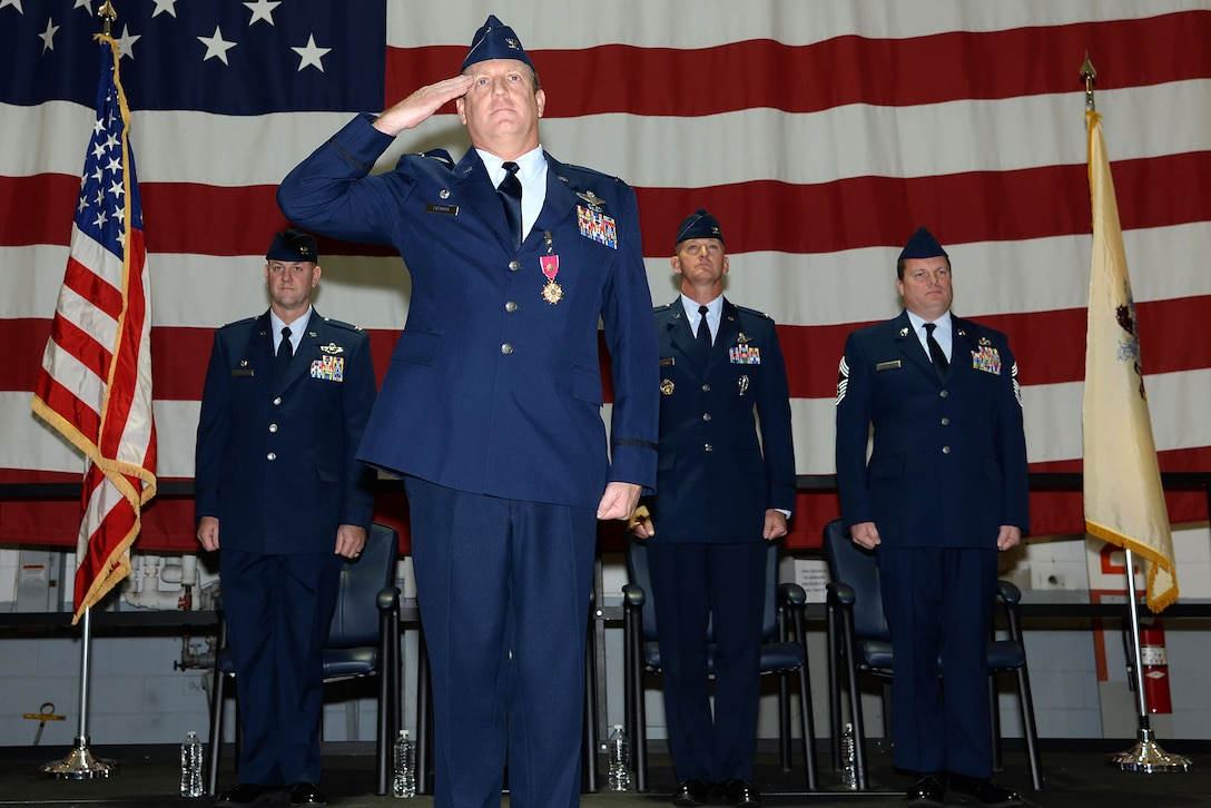 A picture of U.S. Air Force Col. Bradford R. Everman, outgoing operations group commander and future commander of the 177th Fighter Wing, giving his final salute the as the operations group commander.