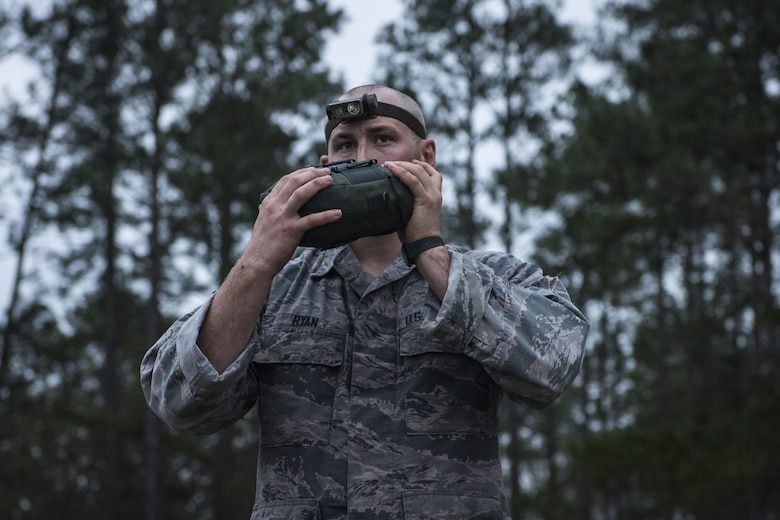 An Airman hydrates after completing a 12-mile ruck march during a Pre Ranger Assessment Course, Feb. 11, 2018, at Moody Air Force Base, Ga. The three-day assessment is designed to determine whether Airmen are ready to attend the Air Force Ranger Assessment Course held at Fort Bliss Army Post, Texas. Ranger cadre test Airmen's physical fitness, tactical abilities, land navigation skills, leadership qualities, water confidence and academic ability to determine if they have the knowledge and will to become Rangers. (U.S. Air Force photo by Senior Airman Janiqua P. Robinson)