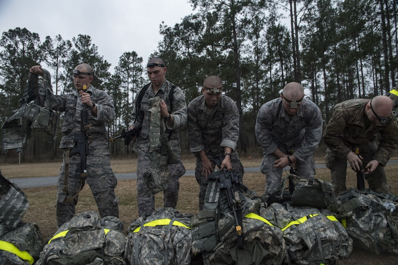 Airmen don gear during a Pre Ranger Assessment Course, Feb. 11, 2018, at Moody Air Force Base, Ga. The three-day assessment is designed to determine whether Airmen are ready to attend the Air Force Ranger Assessment Course held at Fort Bliss Army Post, Texas. Ranger cadre test Airmen's physical fitness, tactical abilities, land navigation skills, leadership qualities, water confidence and academic ability to determine if they have the knowledge and will to become Rangers. (U.S. Air Force photo by Senior Airman Janiqua P. Robinson)