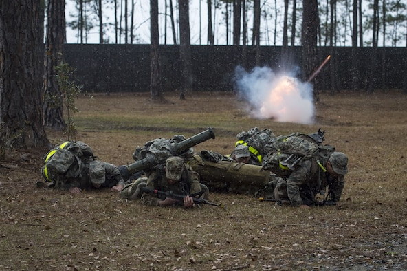 Airmen duck for cover as a non-lethal grenade explodes during a Pre Ranger Assessment Course, Feb. 11, 2018, at Moody Air Force Base, Ga. The three-day assessment is designed to determine whether Airmen are ready to attend the Air Force Ranger Assessment Course held at Fort Bliss Army Post, Texas. Ranger cadre test Airmen's physical fitness, tactical abilities, land navigation skills, leadership qualities, water confidence and academic ability to determine if they have the knowledge and will to become Rangers. (U.S. Air Force photo by Senior Airman Janiqua P. Robinson)