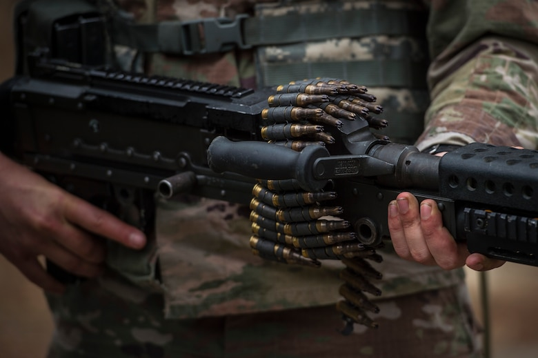 An Airman carries a M240B machine gun during a Pre Ranger Assessment Course, Feb. 11, 2018, at Moody Air Force Base, Ga. The three-day assessment is designed to determine whether Airmen are ready to attend the Air Force Ranger Assessment Course held at Fort Bliss Army Post, Texas. Ranger cadre test Airmen's physical fitness, tactical abilities, land navigation skills, leadership qualities, water confidence and academic ability to determine if they have the knowledge and will to become Rangers. (U.S. Air Force photo by Senior Airman Janiqua P. Robinson)