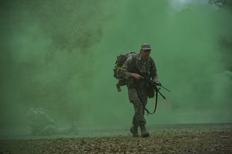 An Airman treks through smoke during a Pre Ranger Assessment Course, Feb. 11, 2018, at Moody Air Force Base, Ga. The three-day assessment is designed to determine whether Airmen are ready to attend the Air Force Ranger Assessment Course held at Fort Bliss Army Post, Texas. Ranger cadre test Airmen's physical fitness, tactical abilities, land navigation skills, leadership qualities, water confidence and academic ability to determine if they have the knowledge and will to become Rangers. (U.S. Air Force photo by Senior Airman Janiqua P. Robinson)
