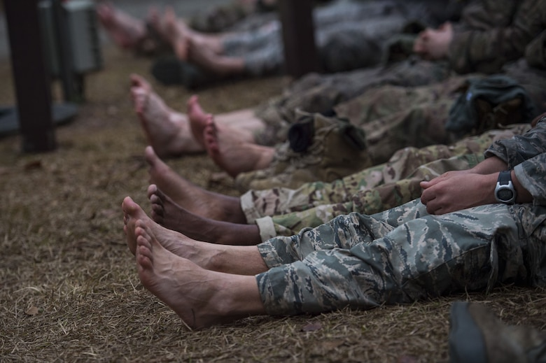 Airmen air out their feet during a Pre Ranger Assessment Course, Feb. 11, 2018, at Moody Air Force Base, Ga. The three-day assessment is designed to determine whether Airmen are ready to attend the Air Force Ranger Assessment Course held at Fort Bliss Army Post, Texas. Ranger cadre test Airmen's physical fitness, tactical abilities, land navigation skills, leadership qualities, water confidence and academic ability to determine if they have the knowledge and will to become Rangers. (U.S. Air Force photo by Senior Airman Janiqua P. Robinson)