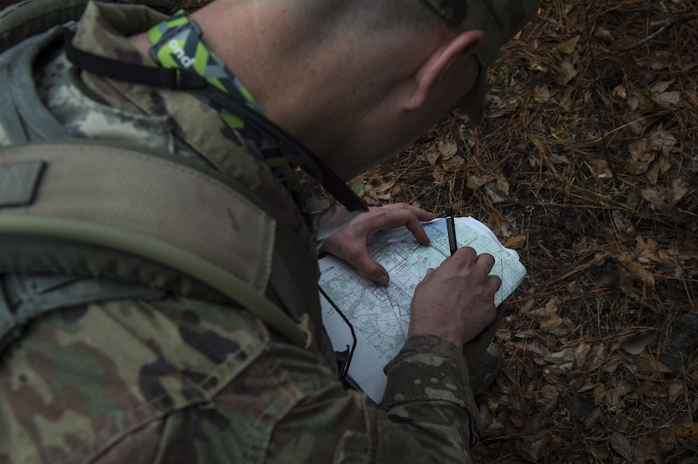An Airman uses a protractor to calculate distance during a Pre Ranger Assessment Course, Feb. 10, 2018, at Moody Air Force Base, Ga. The three-day assessment is designed to determine whether Airmen are ready to attend the Air Force Ranger Assessment Course held at Fort Bliss Army Post, Texas. Ranger cadre test Airmen's physical fitness, tactical abilities, land navigation skills, leadership qualities, water confidence and academic ability to determine if they have the knowledge and will to become Rangers. (U.S. Air Force photo by Senior Airman Janiqua P. Robinson)