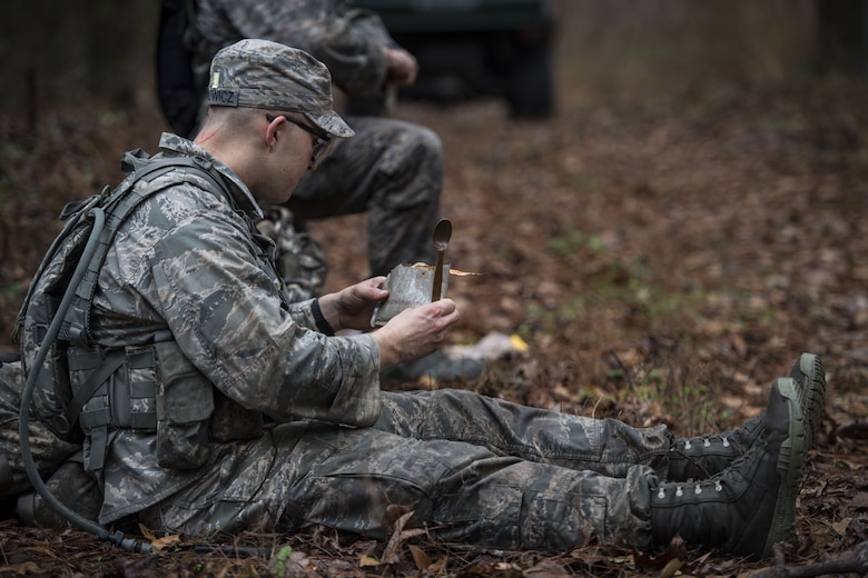 An Airman eats a Meal-Ready to Eat during a Pre Ranger Assessment Course, Feb. 10, 2018, at Moody Air Force Base, Ga. The three-day assessment is designed to determine whether Airmen are ready to attend the Air Force Ranger Assessment Course held at Fort Bliss Army Post, Texas. Ranger cadre test Airmen's physical fitness, tactical abilities, land navigation skills, leadership qualities, water confidence and academic ability to determine if they have the knowledge and will to become Rangers. (U.S. Air Force photo by Senior Airman Janiqua P. Robinson)