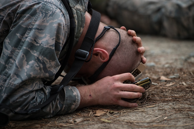 An Airman protects his head during a Pre Ranger Assessment Course, Feb. 11, 2018, at Moody Air Force Base, Ga. The three-day assessment is designed to determine whether Airmen are ready to attend the Air Force Ranger Assessment Course held at Fort Bliss Army Post, Texas. Ranger cadre test Airmen's physical fitness, tactical abilities, land navigation skills, leadership qualities, water confidence and academic ability to determine if they have the knowledge and will to become Rangers. (U.S. Air Force photo by Senior Airman Janiqua P. Robinson)