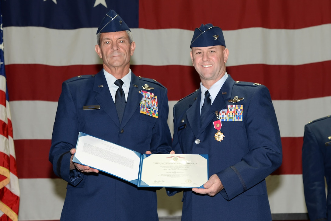 A picture of U.S. Air Force Col. John R. DiDonna, Jr., commander of the 177th Fighter Wing, and Brig. Gen. Kevin J. Keehn, commander of the New Jersey Air National Guard, holding an award.
