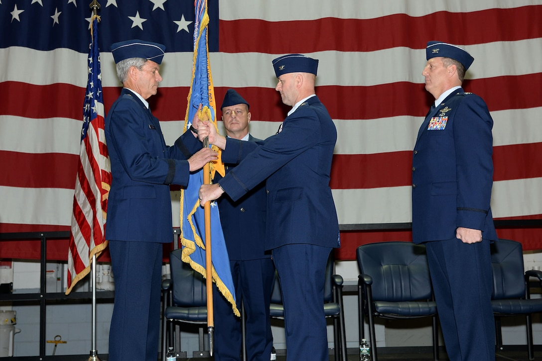 A picture of U.S. Air Force Col. John R. DiDonna, Jr., outgoing 177th Fighter Wing commander, passing the 177th FW guidon to Brig. Gen. Kevin J. Keehn, commander of the New Jersey Air National Guard.