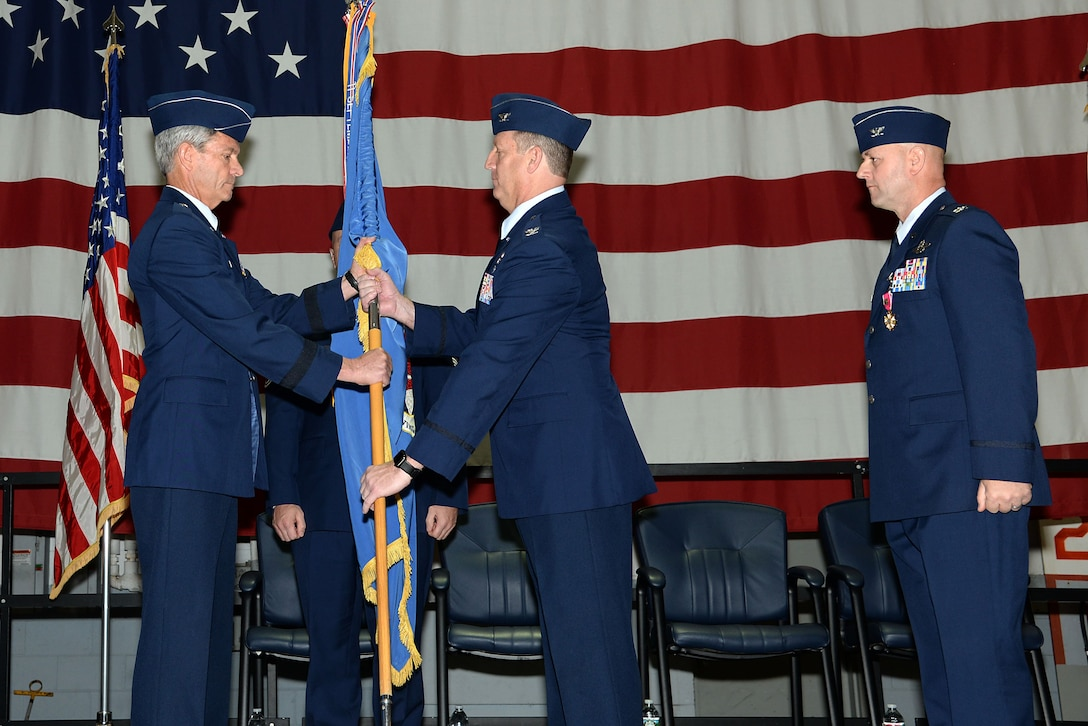 A picture of U.S. Air Force Col. Bradford R. Everman, the outgoing 177th Operations Group commander and future 177th Fighter Wing Commander, receiving the 177th FW guidon from Brig. Gen. Kevin J. Keehn, commander of the New Jersey Air National Guard.