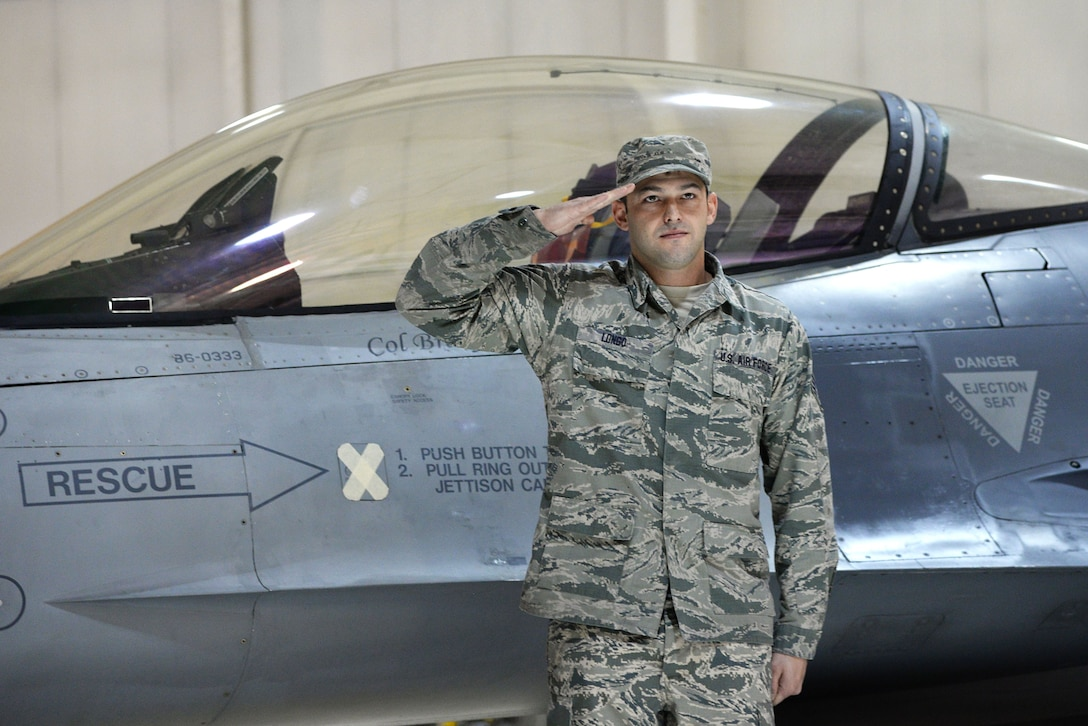 A picture of U.S. Air Force Staff Sgt. Richard E. Longo, crew chief at the 177th Fighter Wing, saluting Col. Bradford R. Everman, commander of the 177th FW.