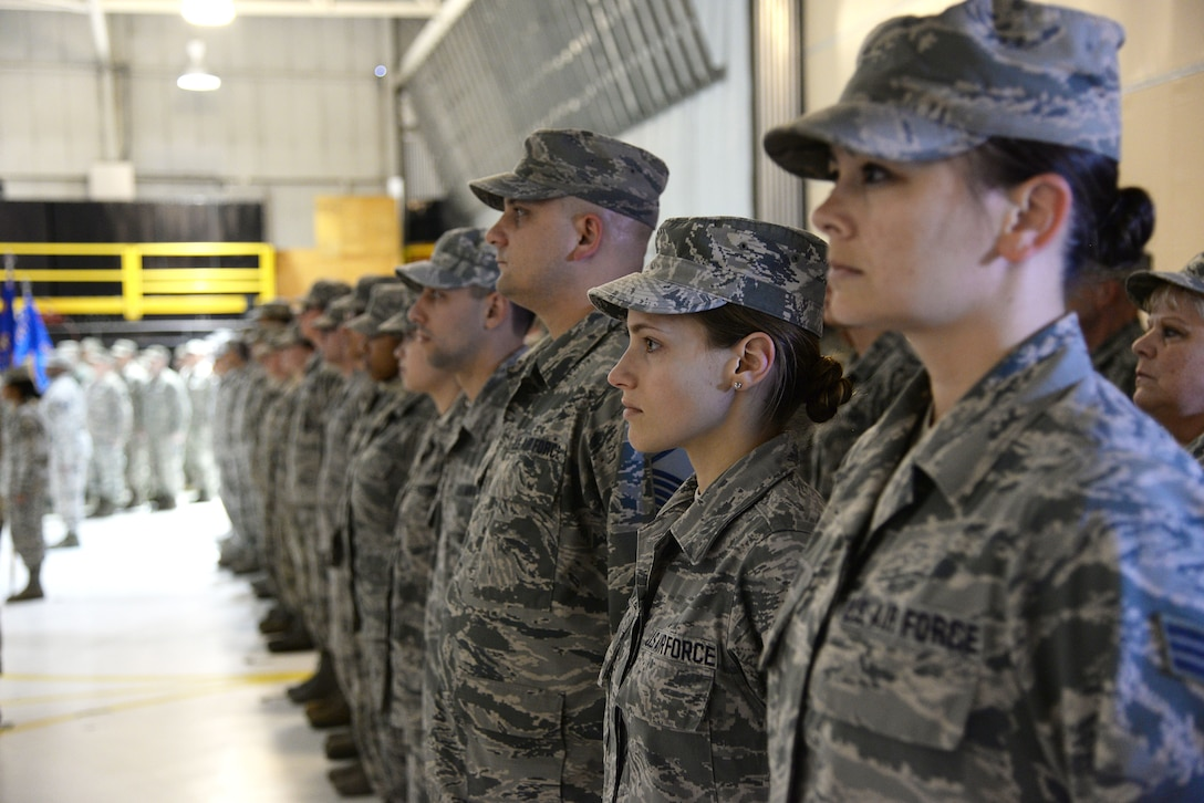 A picture of airmen from the 177th Fighter Wing standing in formation during a change of command ceremony.