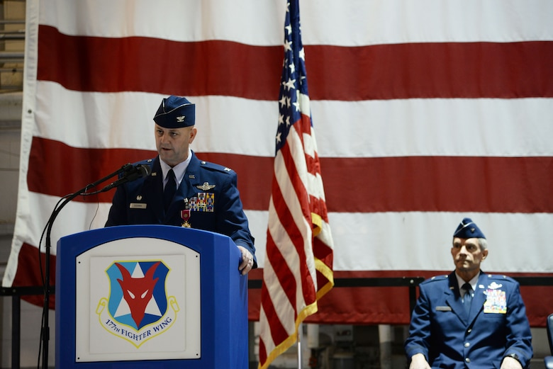A picture of the Commander of the 177th Fighter Wing Col. John R. DiDonna delivering his farewell speech.