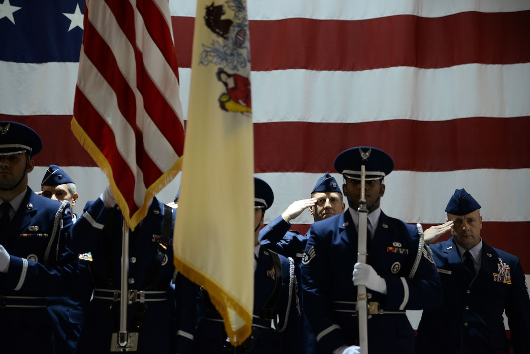 A picture of members of the New Jersey Air National Guard's 177th Fighter Wing saluting during the playing of the National Anthem during the 177th.