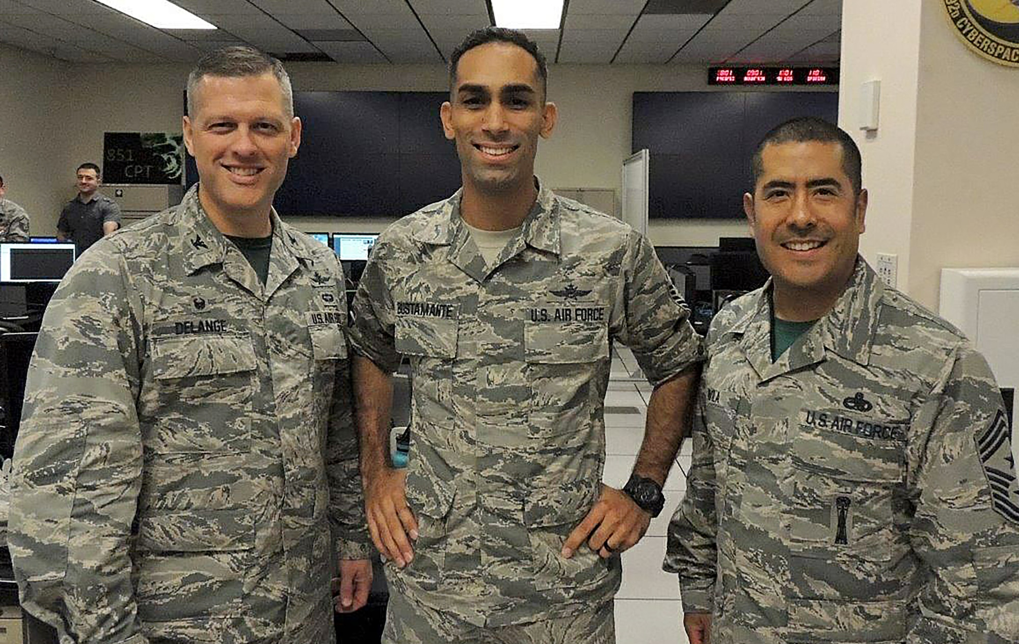 Col. Eric Delange, 688th Cyberspace Wing Commander (left), and Chief Master Sgt. Emilio Avila, 688th CW command chief (right), congratulate Master Sgt. Anthony Bustamante, 92nd Cyberspace Operations Squadron flight chief, on being selected as one of the first Airmen to undergo direct appointment into the Air Force cyberspace officer corps. Direct appointment for cyberspace officers was authorized under the 2017 National Defense Authorization Act. The candidates' experience will be used to develop policies and procedures for future applicants. (Courtesy photo)