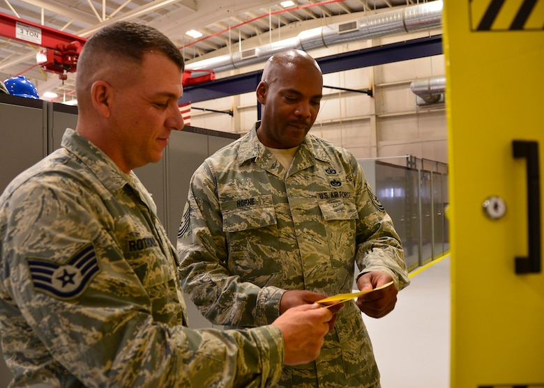 Master Sgt. James Horne, a 919th Special Operations Wing occupational safety specialist, right, conducts an annual facility inspection