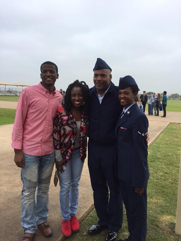 Master Sgt. James Horne poses for a photo with his three grown children at Joint Base Lackland