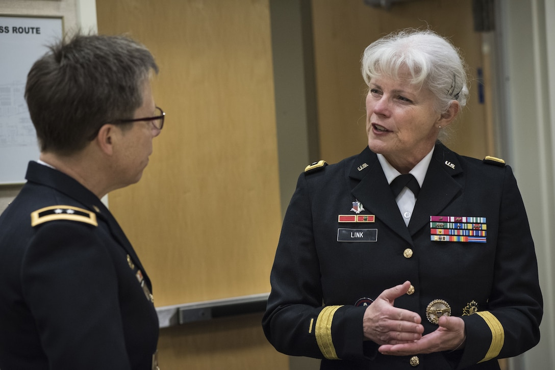 Maj. Gen. Mary Link, commanding general for Army Reserve Medical Command, speaks with Maj. Gen. Tammy Smith, assistant deputy chief of staff for Mobilization and Reserve Affairs before participating in the Women Leadership Roundtable Discussion, hosted at the Pentagon, Feb. 7, 2018. Top U.S. military generals met with congressional delegates to discuss their life perspectives as military women and the importance of having access to every talented American who can add strength to the force. (U.S. Army Reserve photo by Maj. Valerie Palacios)