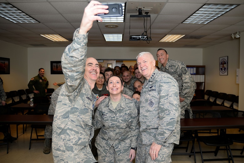 A picture of U.S. Air Force Lt. Gen. L. Scott Rice, director of the Air National Guard, and Command Chief Master Sgt. Ronald C. Anderson, command chief master sergeant of the ANG, taking a selfie with the Airmen of the Medical Group at the 177th Fighter Wing.