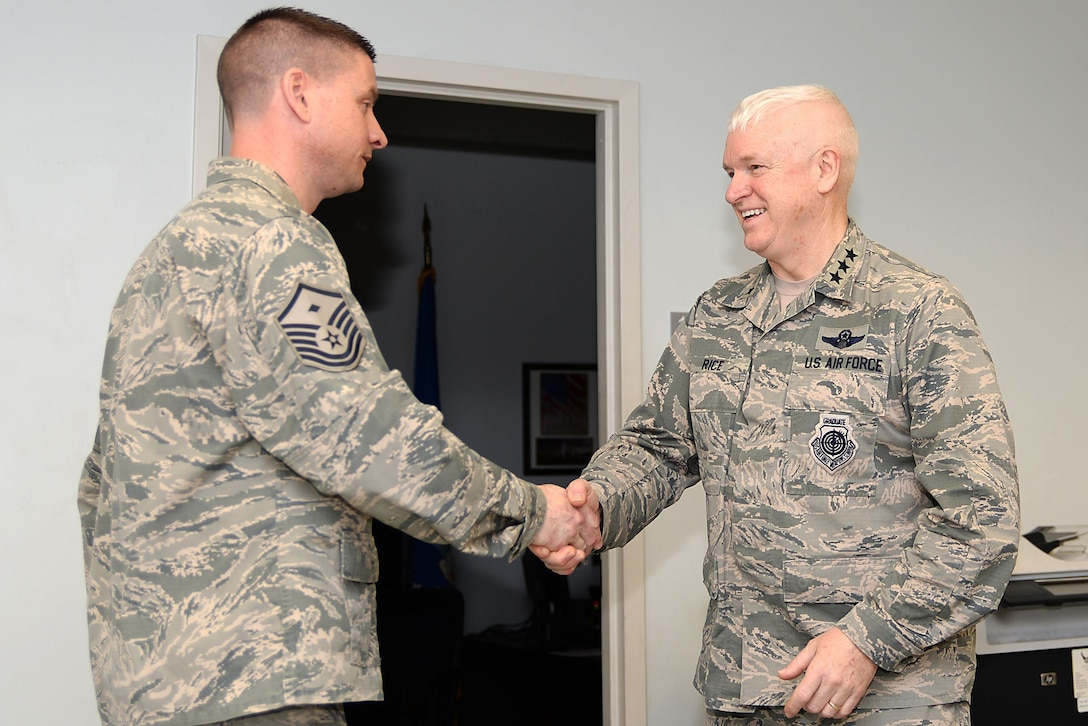 A picture of U.S. Air Force Lt. Gen. L. Scott Rice, director of the Air National Guard,shaking the hand of Master Sgt. David M. Burr, 177th Fighter Wing Maintenance Squadron First Sergeant.