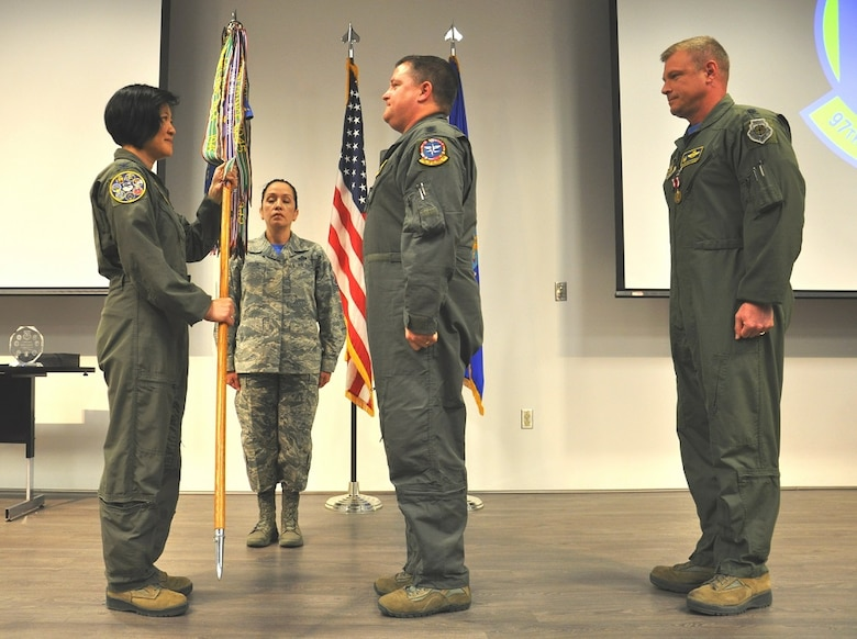 Col. Janette Thode, 340th Flying Training Group commander, prepares to present the guidon to Lt. Col. Michael Rose, incoming 97th Flying Training Squadron commander. (U.S. Air Force photo by Debi Smith)