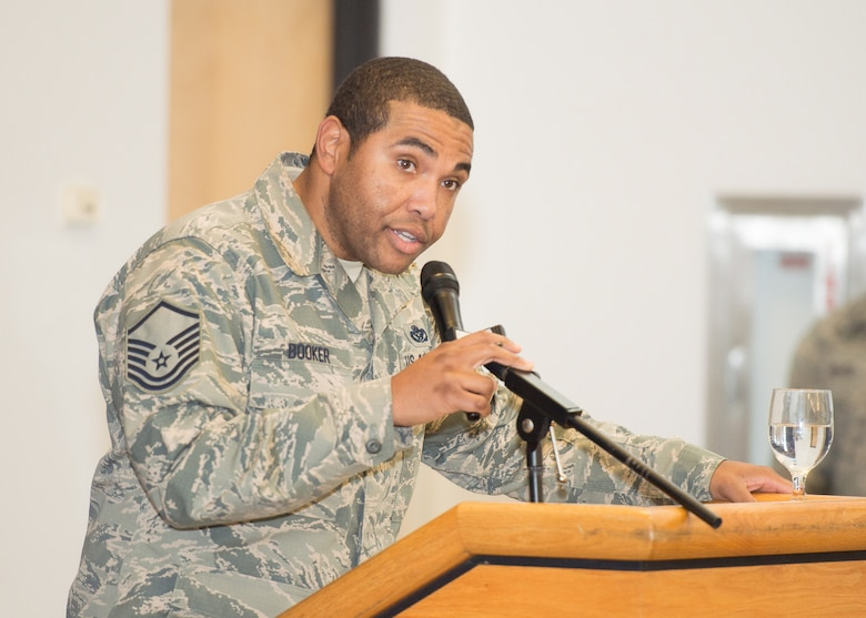 "Master Sgt. Forrest Booker, 436th Civil Engineer Squadron heavy repair superintendent, recites the poem ""The Negro Soldier"" by Roscoe C. Jamison at the Black History Month Luncheon Feb. 6, 2018, on Dover Air Force Base, Del. Written shortly after World War I, the poem celebrates African American soldiers who bravely fought and died during the war. (U.S. Air Force photo by Mauricio Campino)"