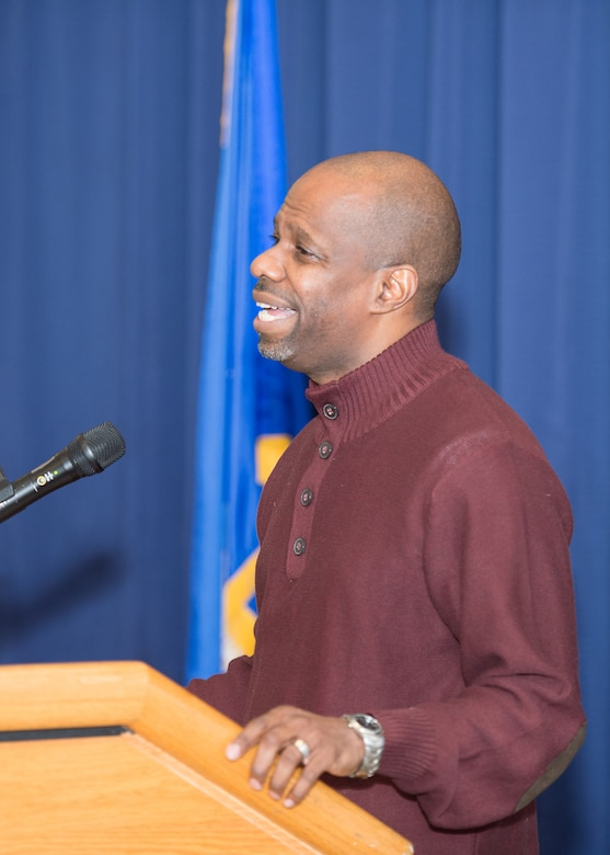 "Troy Purnell, U.S. Capitol Police Dept., performs ""Lift Every Voice and Sing"" during the Black History Month Luncheon Feb. 6, 2018, on Dover Air Force Base, Del. The song, originally written as a poem by James Weldon Johnson, is often referred to as the ""African American National Anthem."" (U.S. Air Force photo by Mauricio Campino)"