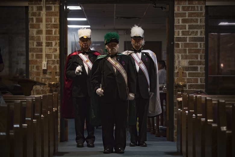 Members of the Knights of Columbus, council 4913, enter into a sanctuary shortly before Bishop Robert J. Coyle, Archdiocese of the Military Services, performs a Sacrament of Confirmation ceremony, Feb. 12, 2018, at Moody Air Force Base, Ga. Confirmation is the sacrament by which Catholics believe the Holy Spirit gives them the increased ability to practice their faith in every aspect of their lives and to witness Christ in every situation.  The Sacrament of Confirmation helps a person remain faithful to his or her baptismal commitment to witness to Christ and to serve others. (U.S. Air Force photo by Senior Airman Daniel Snider)