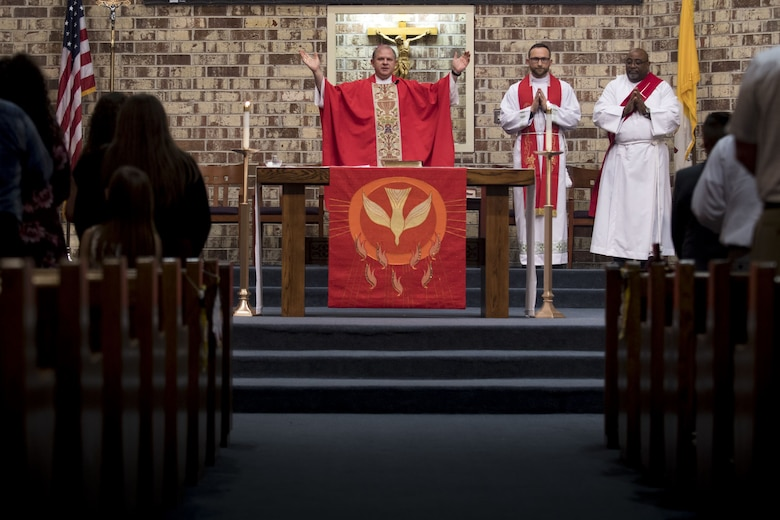 Bishop Robert J. Coyle, Archdiocese of the Military Services, addresses a sanctuary of people, shortly before performing a Sacrament of Confirmation ceremony, Feb. 12, 2018, at Moody Air Force Base, Ga. Confirmation is the sacrament by which Catholics believe the Holy Spirit gives them the increased ability to practice their faith in every aspect of their lives and to witness Christ in every situation.  The Sacrament of Confirmation helps a person remain faithful to his or her baptismal commitment to witness to Christ and to serve others. (U.S. Air Force photo by Senior Airman Daniel Snider)