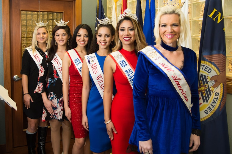 From left to right are Jordan Jones, Miss Brandywine 2018, Miss America System; Rebecca Gasperetti, Miss Hockessin 2018, Miss America System; Angel Paro-Pringle, Mrs. New Castle, Delaware America 2018; Joanna Wicks, Miss Wilmington 2018, Miss America System; Ivana Hamilton, Mrs. Delaware America 2017; and Allison Rae Funds, All American Ambassador 2018, at the National Pizza Day celebration Feb. 9, 2018, at the USO on Dover Air Force Base, Del. To celebrate the day, the USO offered free pizza to Airmen and their families. (U.S. Air Force photo by Mauricio Campino)
