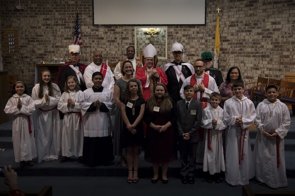 Members of  the Catholic community pose for a group photo with Bishop Robert J. Coyle, Archdiocese of the Military Services, after a Sacrament of Confirmation ceremony, Feb. 12, 2018, at Moody Air Force Base, Ga.