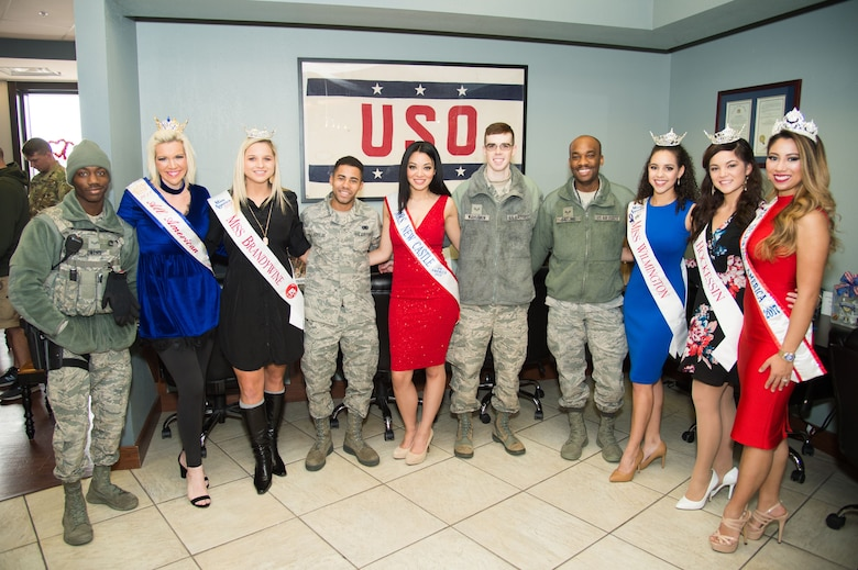 Delaware beauty queens meet Team Dover Airmen at the National Pizza Day event Feb. 9, 2018, at the USO on Dover Air Force Base, Del.  The pageant winners from various cities throughout Delaware volunteered their time to meet Airmen and their families, serve them lunch and sign autographs. (U.S. Air Force photo by Mauricio Campino)