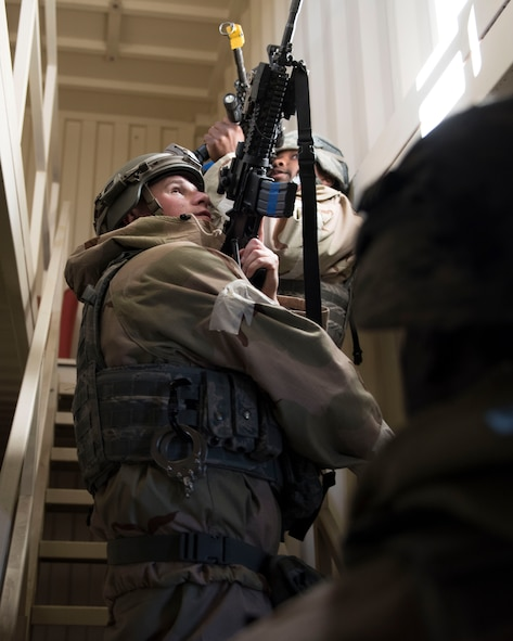 Image of Staff Sgt. Sean Richardson, 366th Security Forces Squadron response force leader, and Airmen from the 366th SFS clear a building during exercise Gunslinger 18-4 at Mountain Home Air Force Base, Idaho, February 6, 2018. The base participated in a week-long exercise to train for potential real-world contingencies. (U.S. Air Force photo by Airman 1st Class Alaysia Berry)