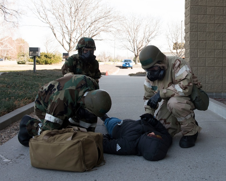 Image of 366th Fighter Wing Airmen treat a simulated victim while conducting a post-attack reconnaissance during exercise Gunslinger 18-4 Feb. 7, 2018, at Mountain Home Air Force Base, Idaho. The base participated in a week-long exercise to train for potential real-world contingencies. (U.S. Air Force photo by Airman 1st Class Alaysia Berry)