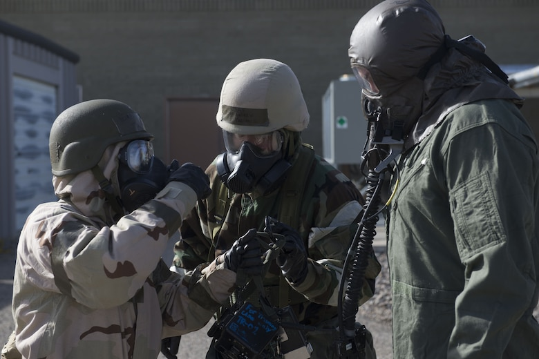 Image of 366th Operations Support Squadron Airmen take a 366th Fighter Wing pilot to the next decontamination station Feb. 7, 2018, at Mountain Home Air Force Base, Idaho. The base participated in a week-long exercise to train for potential real-world contingencies. (U.S. Air Force photo by Airman 1st Class JaNae Capuno)