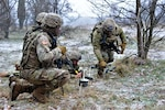 Engineers of Lightning Troop, 3rd Squadron, 2nd Cavalry Regiment, assigned to the Battle Group Poland, set up the detonation cords for breach operations during Dire Wolf II, platoon live-fire exercise near Bemowo Piskie Training Area, Poland.