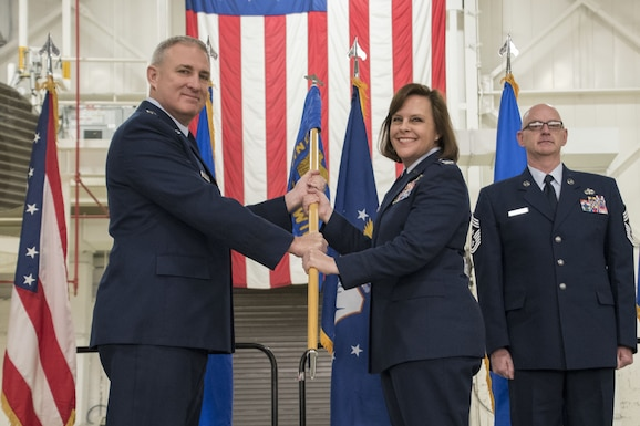 Maj. Gen. Stephen E. Malkovich, the Commander of the Ohio Air National Guard, passes the ceremonial guidon to Col. Allison Miller at the Assumption of Command ceremony Feb. 3, 2018, at the 179th Airlift Wing, Mansfield, Ohio. Col. Miller is the first female commander of an Ohio Air Guard unit