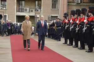 Defense Secretary James N. Mattis walks with Italian Defense Minister Roberta Pinotti in Rome.