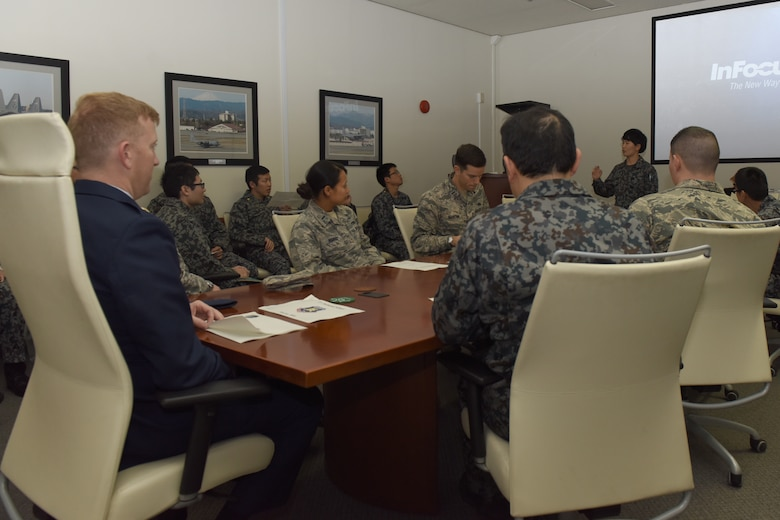 U.S. Air Force officers from across the 374th Maintenance Group partake in a presentation given by the Koku Jietai Cadets following the Basic Maintenance Officer Tour at Yokota Air Base, Japan, Feb. 1, 2018.