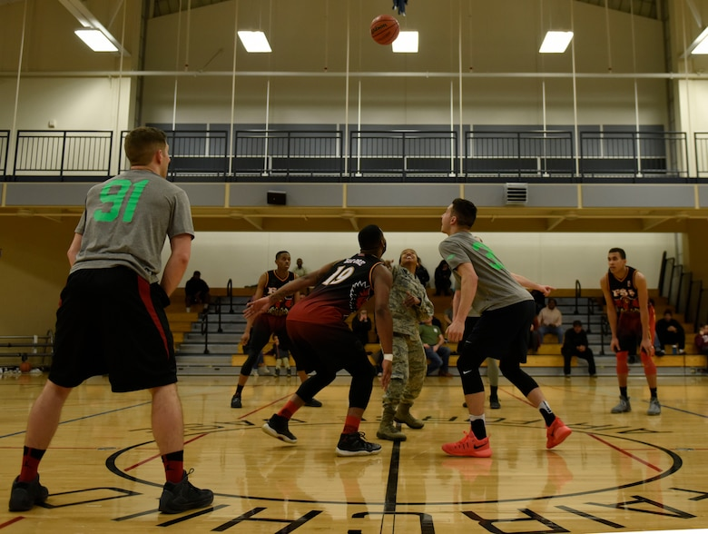 "Col. Yvonne Spencer, 92nd Mission Support Group commander, conducts a ""jump ball"" to kick off the Intramural Basketball Season Championship at Fairchild Air Force Base, Washington, Feb. 7, 2018. The 92nd Force Support Squadron and the 336th Training Group basketball teams competed for the championship. (U.S. Air Force photo/Airman 1st Class Jesenia Landaverde)"