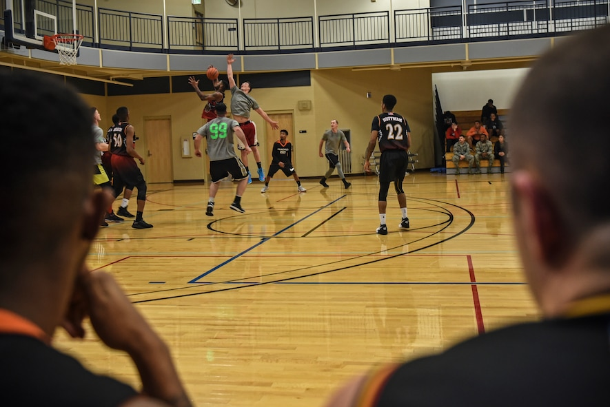 The 92nd Force Support Squadron and the 336th Training Group basketball temas compete in the Intramural Basketball championship Feb. 7, 2018, at Fairchild Air Force Base, Washington. The 92nd FSS held the lead during both halves with the 336th TRG close behind. (U.S. Air Force photo/ Airman 1st Class Whitney Laine)