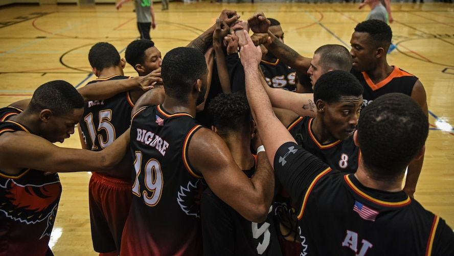 The 92nd Force Support Squadron basketball team huddles after claiming victory at the Intramural Basketball championship Feb. 7, 2018, at Fairchild Air Force Base, Washington. The game ended with a final score of 50 to 45, determining the 92nd FSS the champions.(U.S. Air Force photo/Airman 1st Class Whitney Laine)