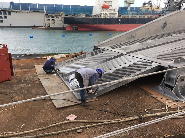 The expeditionary fast transport ship USNS Fall River (T-EPF-4) conducts weld repairs on the stern ramp during a voyage repair availability in Laem Chabang, Thailand, Feb. 12. Fall River is assigned to Destroyer Squadron 7 in U.S. 7th Fleet area of responsibility, providing logistical solutions to the region's littorals and working hull-to-hull with partner navies to provide 7th Fleet with the flexible capabilities it needs now and in the future.