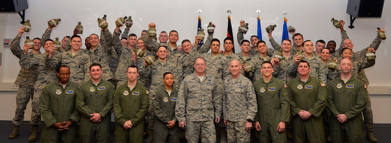 Graduates of the Phoenix Raven Qualification Course pose for a class photo with their instructors and and leadership on Ramstein Air Base, Germany, on Feb. 12, 2018. U.S. Air Forces in Europe-Air Forces Africa and 86th Airlift Wing leadership requested a mobile training team to come and direct the Raven course at Ramstein. (U.S. Air Force photo by Senior Airman Joshua Magbanua)