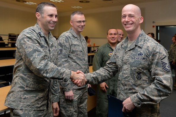 U.S. Air Force Master Sgt. Edward Mann IV, 86th Security Forces Squadron flight chief, left, shakes hands after his graduation from the Phoenix Raven Qualification Course on Ramstein Air Base, Germany, Feb. 12, 2018. A mobile training team came from Joint Base McGuire-Dix-Lakehurst, N.J., to conduct the course within U.S. Air Forces in Europe-Air Forces in Europe-Air Forces Africa. (U.S. Air Force photo by Senior Airman Joshua Magbanua)