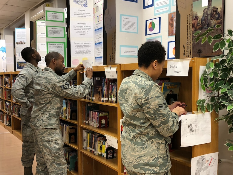 U.S. Air Force Airmen in a library