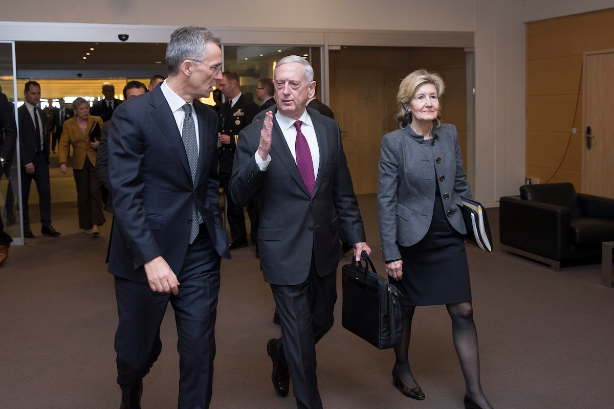 Defense Secretary James N. Mattis walks with NATO leaders in Brussels.