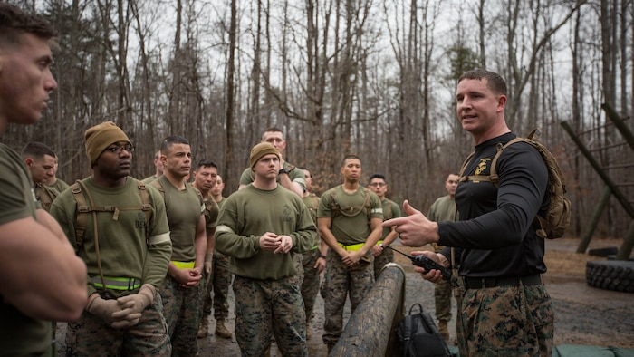 U.S. Marine Corps Staff Sgt. Joshua Owen (right), explains the conduct of the Force Fitness Instructor (FFI) Course culminating event at The Basic School, Marine Corps Base Quantico, Va., February 12, 2018. The FFI course is made up of physical training, classroom instruction and practical application to provide the students with a holistic approach to fitness. Upon completion, the Marines will serve as unit FFIs, capable of designing individual and unit-level holistic fitness programs.